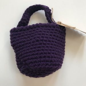 Crocheted small basket in purple